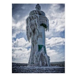 Faro congelado en la orilla del mar Báltico Postal