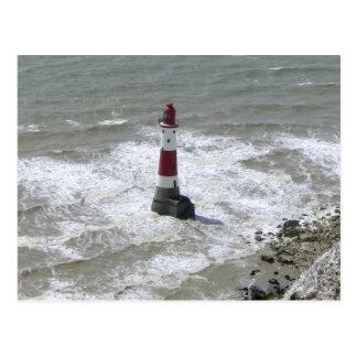 Faro de la cabeza con playas Sussex del este Postales