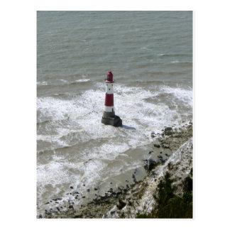 Faro de la cabeza con playas Sussex del este Tarjetas Postales