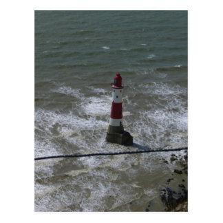 Faro de la cabeza con playas Sussex del este Postal
