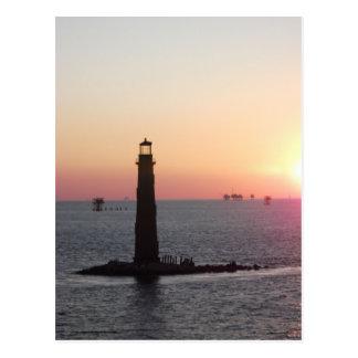 Faro de la isla de la arena en la puesta del sol 2 tarjetas postales