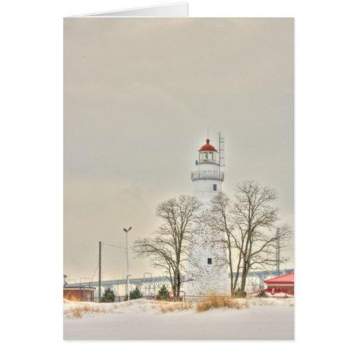 Faro de la playa en la nieve tarjeta de felicitación