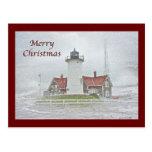 Faro en Felices Navidad de la nieve Postales
