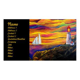 Faro en la puesta del sol con el velero tarjetas de visita