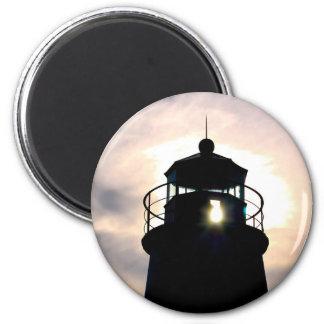 Faro en la puesta del sol imán redondo 5 cm