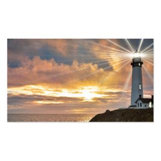 Faro en la puesta del sol tarjetas de visita