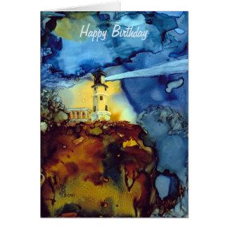 Faro partido de la roca en la noche tarjeta de felicitación