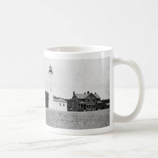 Faro quebradizo del punto taza de café