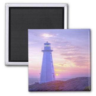 Faro y una puesta del sol imán cuadrado