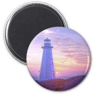 Faro y una puesta del sol imán redondo 5 cm