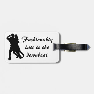 Fashionably late to the downbeat - luggage tag