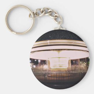 Fast-motion merry-go-round at night keychain