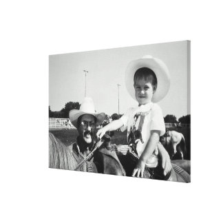 Father and son (2-4) at rodeo (B&W) Canvas Print