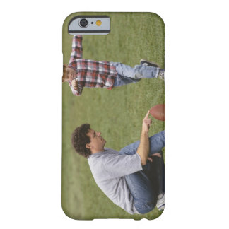 Father and son (4-6) playing American football Barely There iPhone 6 Case