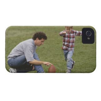 Father and son (4-6) playing American football iPhone 4 Case-Mate Case