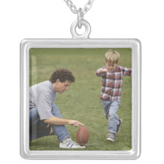 Father and son (4-6) playing American football Silver Plated Necklace