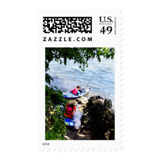 Father and Son Launching Kayaks Stamp
