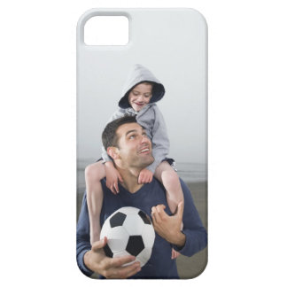 Father carrying son on shoulders and holding iPhone SE/5/5s case