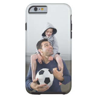Father carrying son on shoulders and holding tough iPhone 6 case