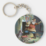 Father Christmas going up the Chimney Key Chain