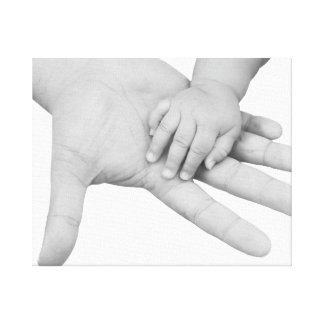Father holding his baby hand stretched canvas print