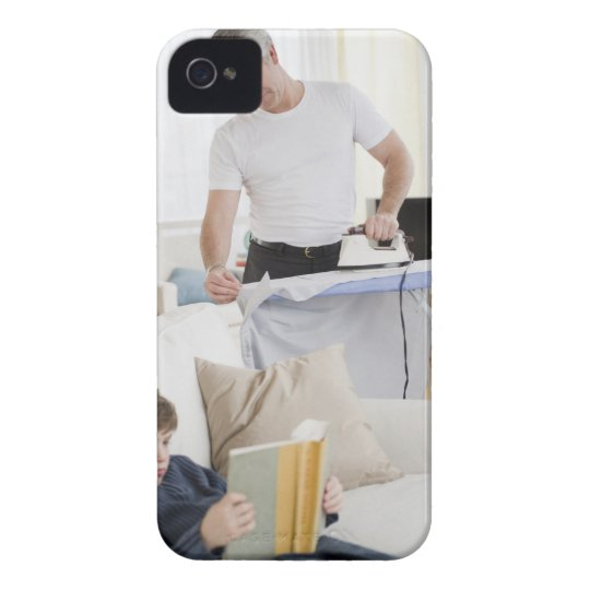 Father ironing iPhone 4 cover