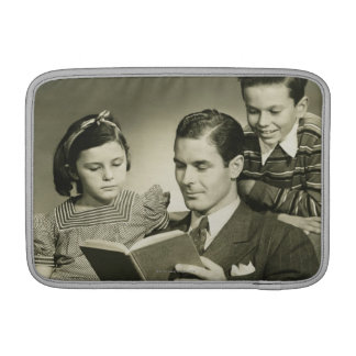 Father Reading to Son MacBook Sleeves