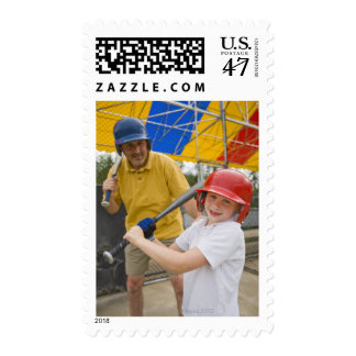 Father with daughter at batting cage postage
