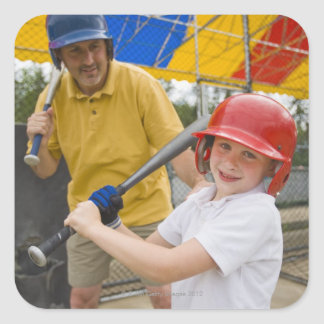 Father with daughter at batting cage square sticker