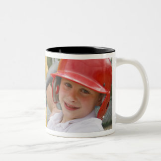 Father with daughter at batting cage Two-Tone coffee mug