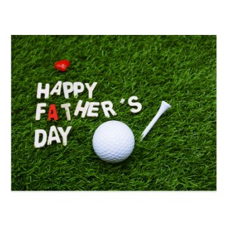 Father's day with golf ball on green postcard