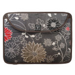 Faux floral textile with red, brown, white flowers MacBook pro sleeves