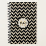 "Faux Glitter Chevron Gold Monogram Planner<br><div class=""desc"">This cover on this notebook planner features a pattern of black chevrons contrasted with silver gold faux glitter chevrons. At the center is your monogram in gold on a circle banner lined in black. Your name is written in black over the monogram. The back cover has the same black and...</div>"