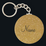 "Faux gold glitter keychain with shiny glimmers<br><div class=""desc"">Faux gold glitter keychain with shiny glimmers. Personalizable name. Cute girly girl gift idea. Stylish typography. Elegant chic luxurious design.</div>"
