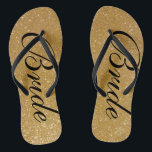 "Faux gold glitter wedding flip flops for bride<br><div class=""desc"">Faux gold glitter wedding flip flops for bride and groom. Custom strap color for him and her. Golden sparkly texture with glittery glimmers and sparkling glimmers. Glamorous beach sandals for men and women. Cute party favor for beach theme wedding, marriage, bridal shower, engagement, anniversary, birthday, bbq, bachelorette, girls weekend trip...</div>"