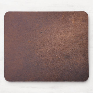 Faux leather, brown with some marks and scratches mouse pad