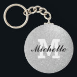 "Faux silver glitter monogram key chain<br><div class=""desc"">Faux silver glitter monogram key chain with glittery glimmers and shiny sparkles. Personalizable name initial letter. Cute girly Birthday girl gift idea or unique wedding favor for bridesmaids,  guests etc. Glamorous monogrammed design with silvery background texture.</div>"