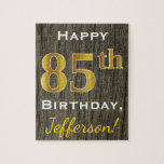 """Faux Wood, Faux Gold 85th Birthday   Custom Name Jigsaw Puzzle<br><div class=""""desc"""">This simple puzzle design features the message &quot;Happy 85th Birthday&quot;,  with the &quot;85th&quot; having a faux gold-like appearance. It also features a custom name,  and a faux wood appearance background. It could be given to somebody who is celebrating their eighty fifth birthday.</div>"""