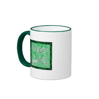 Favorable logotipo del verde de la vida taza de dos colores