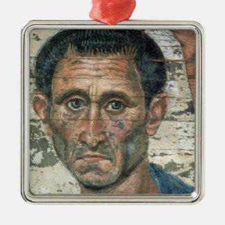 Fayum portrait of a man in a blue cloak, metal ornament
