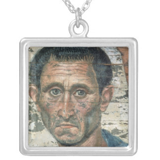 Fayum portrait of a man in a blue cloak, silver plated necklace