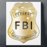 """FBI Badge Plaque<br><div class=""""desc"""">A gold FBI badge isolatrd over a white background</div>"""