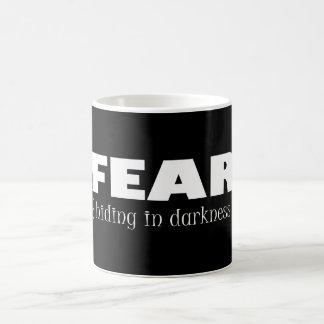 Fear - hiding in darkness coffee mug