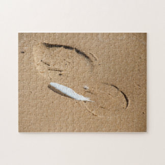 Feather and footprint. jigsaw puzzle