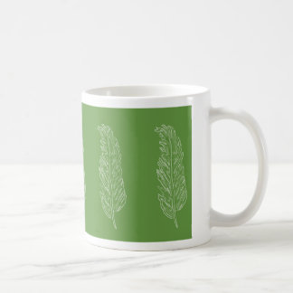 Feather design on a solid background coffee mug