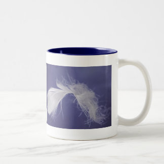 Feathers are symbols of spirituality Two-Tone coffee mug