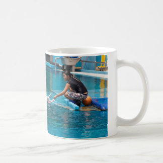 Feeding the dolphins as part of Dolphin show Coffee Mug