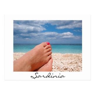 Feet on Sardinia beach white postcard