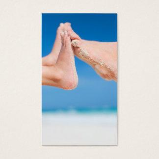 Feet on tropical sand business card