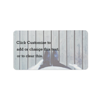 Feet on wooden deck label
